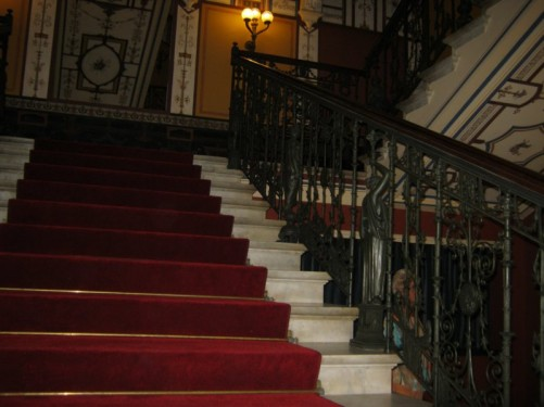 Staircase with elaborate metalwork.