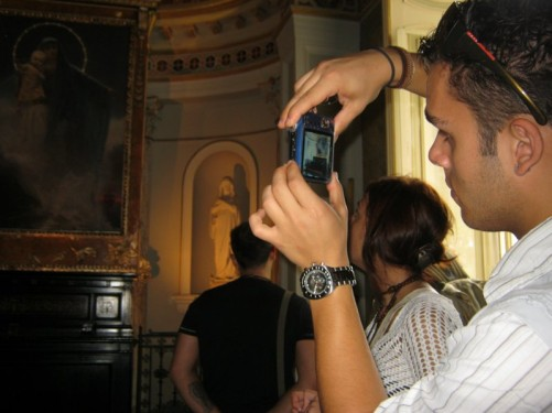 Tourist taking a picture inside the chapel.