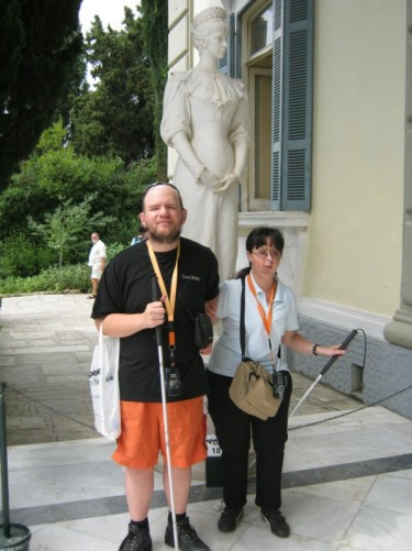 Tony and Tatiana in front of a statue of Empress Elizabeth of Austria at the Achillion Palace.