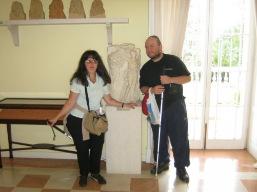 Tatiana and Tony by a Byzantine stone carving at Mon Repos palace museum.
