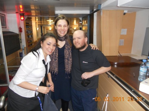 Tony with a lady passenger and a waitress. The waitress's name is Lara.