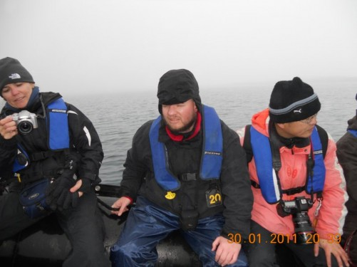 Tony with fellow passengers returning to the ship in a Zodiac inflatable boat from Half Moon Island.