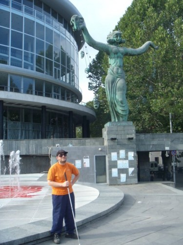Tony outside the Philharmonic Hall. The statue in the background is of a muse holding theatre masks.