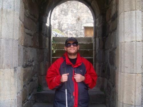 Tony outside a small church in or near Kazbegi.