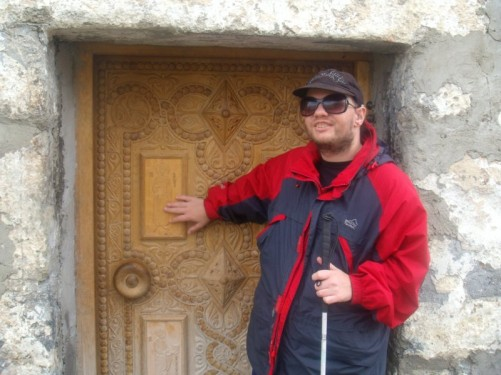 Carved wooden door into the church.