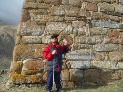 Tony stood in front of the base of a large watchtower in Kazbegi Village. These towers were used to watch for enemies in previous centuries.