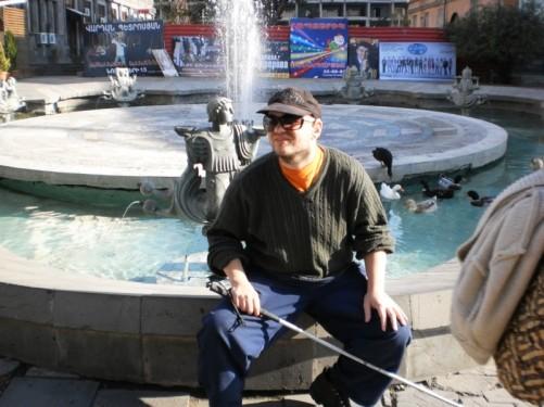 Tony sitting in Fountain Park.