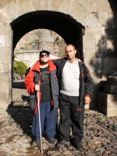 Tony with a guard at the entrance to Gighart Monastery.