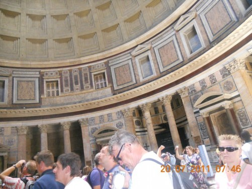 Tourists looking into the Pantheon's dome.