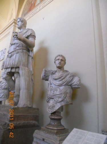 Roman statues inside the Vatican Museums.