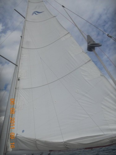 Looking up at the boat's sail.