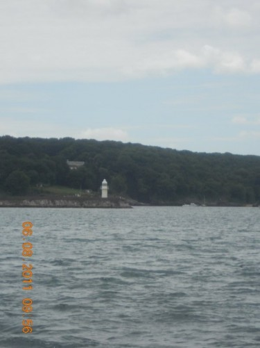 View of a lighthouse in the distance, Tor Bay near Brixham.