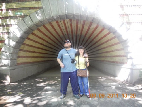 Tony, Tatiana emerging from a long concrete tunnel in the park.