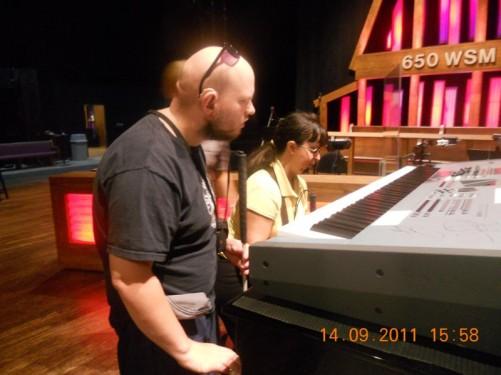 Tony, Tatiana examining a musical keyboard.