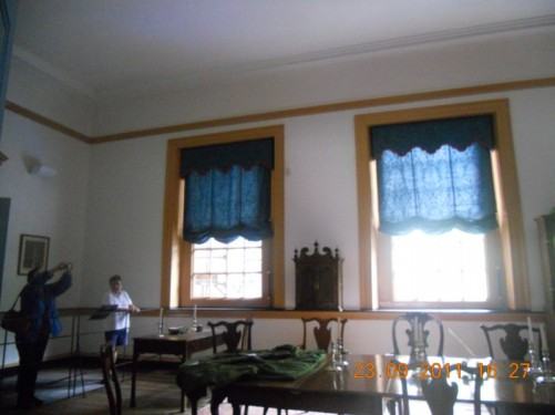 Room with a long table and chairs, inside Congress Hall.