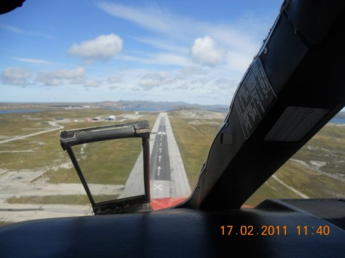 View of the runway at Stanley as the plane prepares to land.
