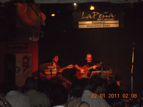 Watching a local band in a bar at night in downtown Buenos Aires.