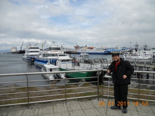 Tony and a view of Ushuaia Harbour behind.