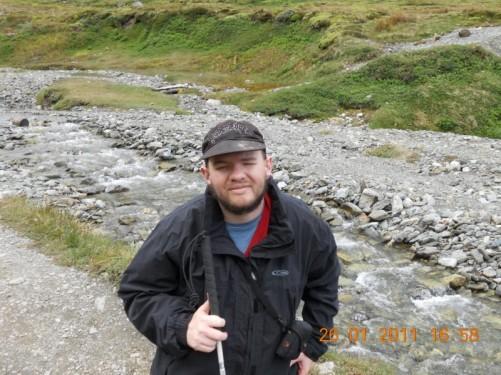 Tony standing next to the stream.