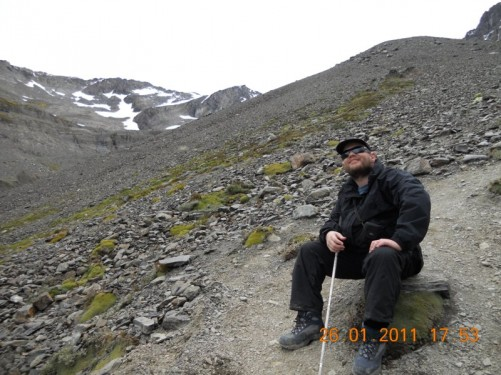Tony sat on a rock having a rest, trail getting steep!