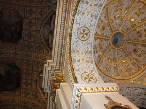 Looking up at the elaborately decorated ceiling, including paintings and gold gilding. St Mary of Jesus church.