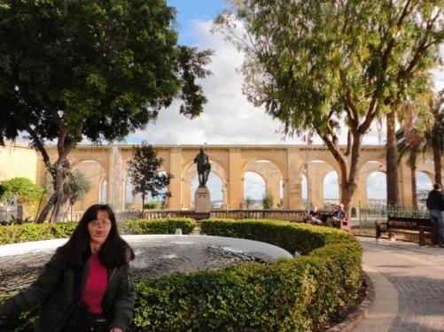 Tatiana on the edge of the fountain, Upper Barrakka Gardens.