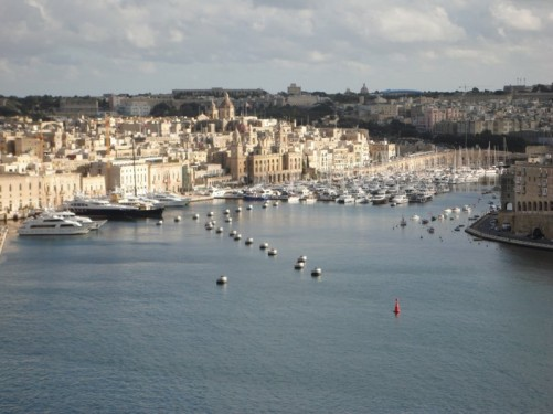 View across the harbour looking into the inlet that separates Senglea and Birgu (Vittoriosa). Many boats moored including large luxury yachts.