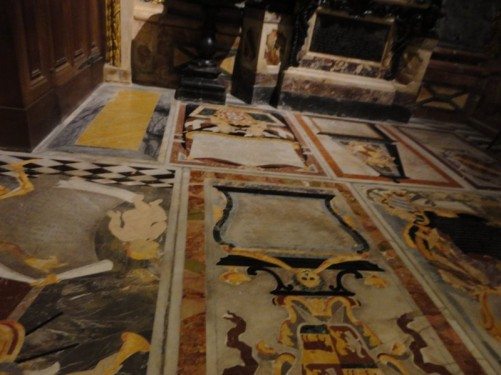 The cathedral floor covered in colourful inlaid marble tomb stones. They belong to knights and date from the 17th and 18th centuries.