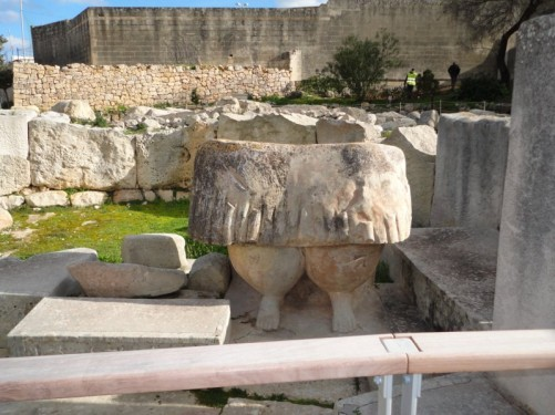 The lower half of a 'fat lady' statue at the Tarxien Neolithic temples site. Originally the statue would have been two metres tall. It is actually a copy as the original has been moved to the National Museum of Archaeology.