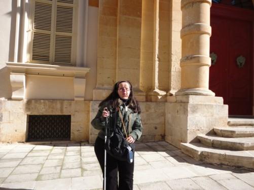 Tatiana standing on Triq Villegaignon in Mdina.