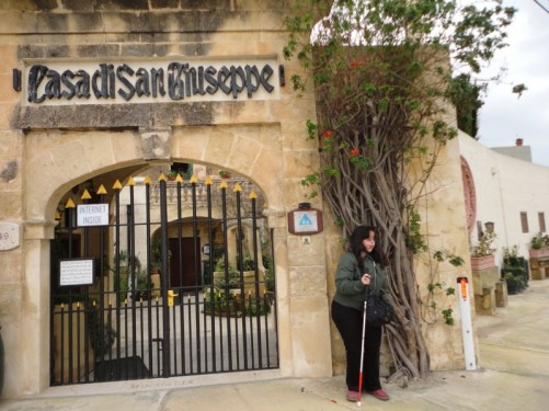 Tatiana at the front gate of St Joseph Home Hostel.