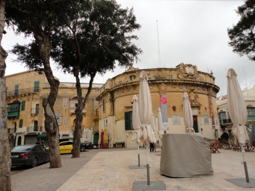 View of Independence Square. The semi-circular Baroque Banca Giuratale is at the far side. This was built in 1773-8 under Grand Master de Vilhena and is now the seat of the local government.