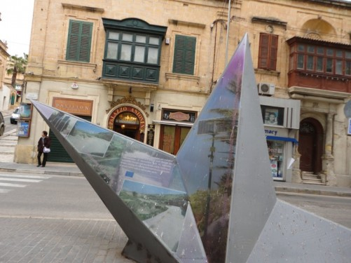 A temporary sculpture in Independence Square - a half-sunken star, with three points visible.