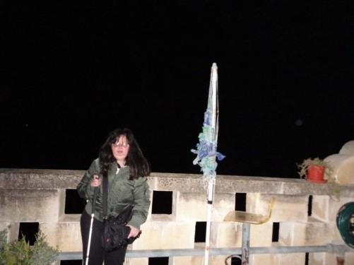 Tatiana standing on the terrace at St Joseph Home Hostel, evening.