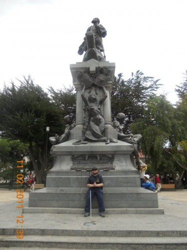 Tony in front of a monument dedicated to Ferdinand Magellan in the main square, Punta Arenas.
