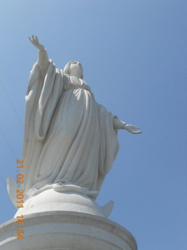 Looking up at the Virgin Mary statue.