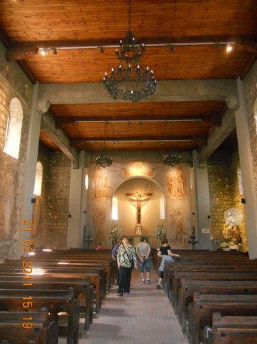 Inside the chapel. Looking down the aisle towards the altar.