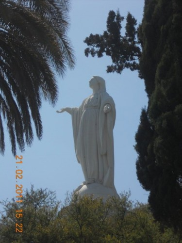 Another view of the large Virgin Mary statue between the trees.