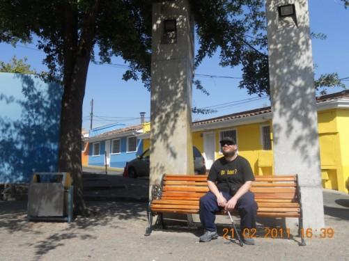 Tony sitting on a bench.