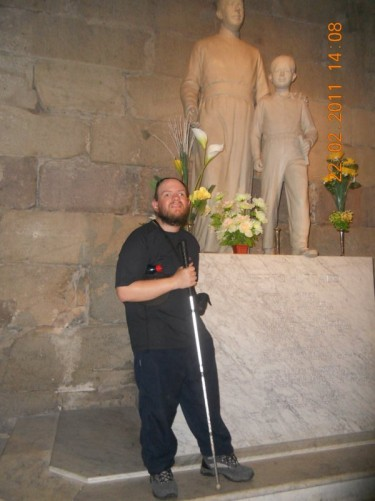 Tony by a pair of statues inside the Metropolitan Cathedral of Santiago.