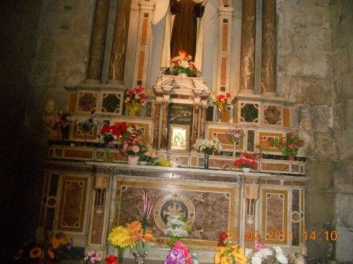 Base of an altar dedicated to Saint Teresa of the Andes, decorated with many flowers.