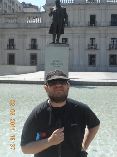 Tony in front of a statue of Arturo Fortunato Alessandri Palma, 18th president of Chile.