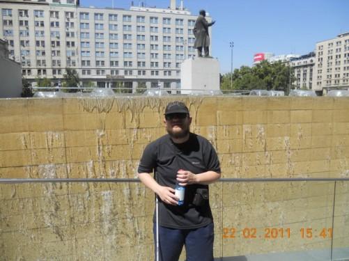 Tony by a fountain (a cascade of water) in Plaza de la Ciudadanía.