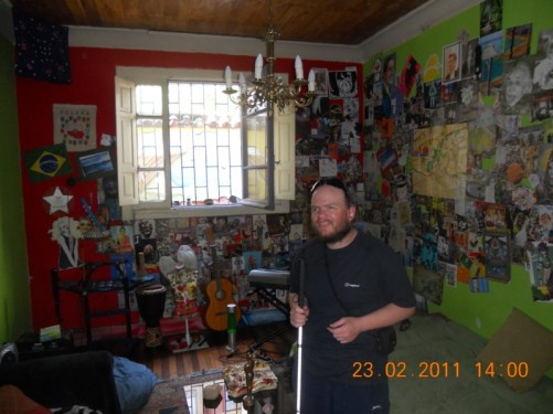 The same room with more decoration on the walls and musical instruments.