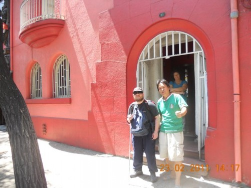 Tony outside Don Santiago Hostel, preparing to leave. Hostel staff seeing him off!