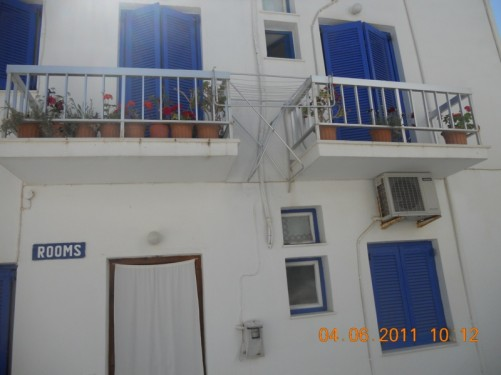 A typical house in Naoussa - white walls with blue shutters on the windows.