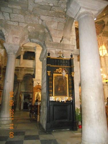 Stone columns and a small altar. Church of Panagia Ekatontapiliani.
