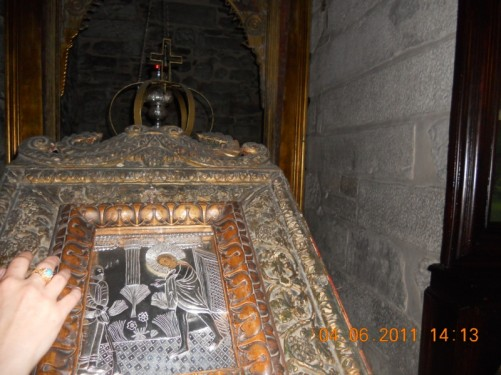 Tatiana touching an embossed metal picture. Church of Panagia Ekatontapiliani.