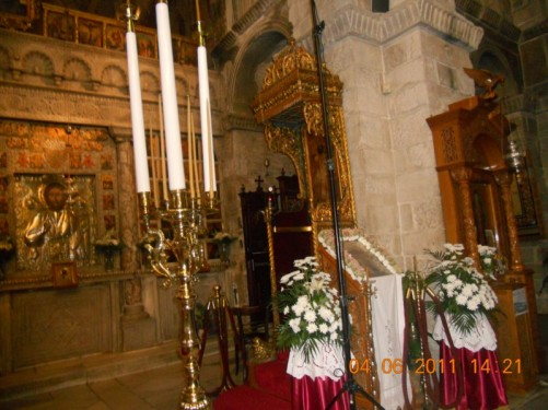 Another view inside the church, including a candelabrum.
