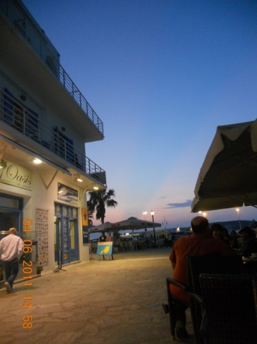 Another view near the harbour. People sitting at outdoor café and restaurant tables.